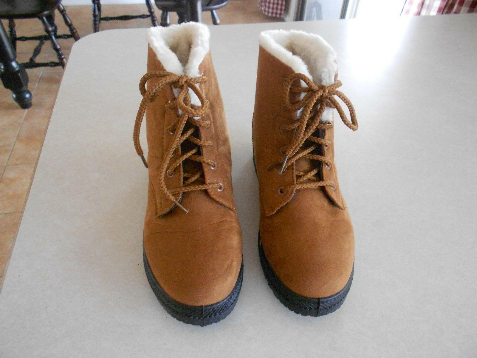 tan light brown boots snow type boots
